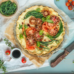 Robiola cheese tart with agretti and tomato