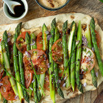 Crispy flat bread with asparagus, tomatoes and peanut hummus