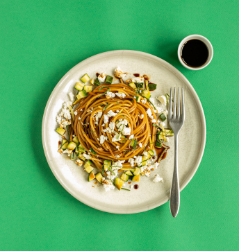 Spaghettini with courgettes, mint, lemon and feta cheese caramelised with Balsamic Vinegar of Modena PGI