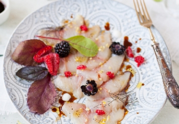 Raw amberjack with red fruits, herbs and Balsamic Vinegar of Modena PGI